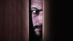 4K Thriller Man Eye Looking Around in Door Gap Stock Footage