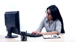 Lazy businesswoman working on computer Stock Footage