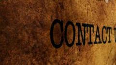 Camera slide on contact grunge text Stock Footage