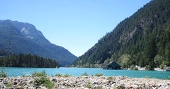 Beautiful Crystal Clear Blue Lake Surrounded by Mountains Stock Footage