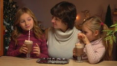 Girls drink hot chocolate through a straw Stock Footage