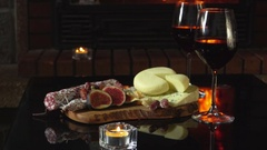 Table with hors d'oeuvres and wine Stock Footage