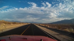 Driving in Death Valley newly paved road at Sunset Stock Footage