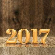Gold shiny 2017 new year (3d rendering) at wooden block table and blur wall Stock Photos