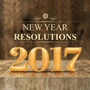 Gold shiny 2017 new year resolutions (3d rendering) at wooden block table Stock Photos