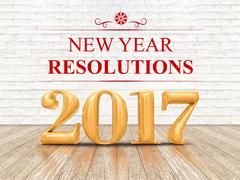 2017 new year resolutions golden color (3d rendering) on white brick wall Stock Photos