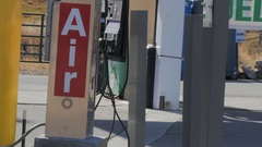 Air pump at gas station Stock Footage