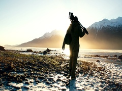 Alaskan Cameraman Walking Toward River Sunflare Slowmo 2K Stock Footage