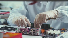 Hands of the master repair of computer technology and microchips Stock Footage