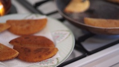 Video chef composes plate of breaded products with carrots Stock Footage