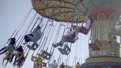 Swing chair ride slow motion adults children having fun going around Stock Footage
