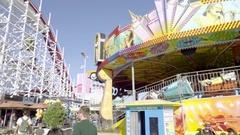 Roller coaster and rides in Santa Cruz Beach Boardwalk amusement park  Stock Footage