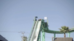 Empty boat splashing down roller coaster water ride in amusement park  Stock Footage