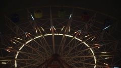 Park attraction ferris wheel carousel swing Night evening with illuminated light Stock Footage