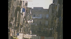 Vintage 16mm film, 1953 Italy Naples, city traffic, fruit wagon, horse cart... Stock Footage