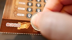 Close up man scratching lottery ticket at bonus section with 4k resolution Stock Footage