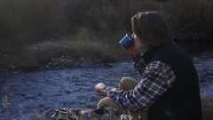 Adventurous Young Man Drinking Cup Of Coffee And Enjoying View Of Water Stock Footage