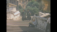 Vintage 16mm film, 1953 Italy, Spanish steps priests people Stock Footage