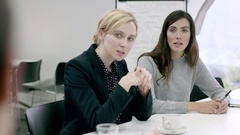 Women Working Together in meeting room Stock Footage