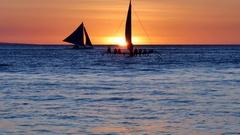 60 fps shot of some undefined tourists enjoying sunset sailing Stock Footage