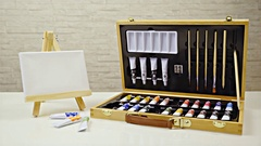 Paint tubes suitcase and small easel with canvas slide around 4K Stock Footage