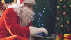 Santa buying gifts use laptop computer Stock Footage