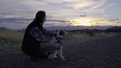 Hiker Bonds With His Adventure Dog On Trail, Pets Her, Enjoy View/Sunset Stock Footage