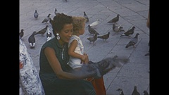 Vintage 16mm film, 1953 Italy, Venice, pigeons and people Stock Footage