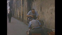 Vintage 16mm film, 1953 Italy, Florence, shoeshine on the street Stock Footage