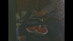 Vintage 16mm film, 1953 Italy, woman eating watermelon Stock Footage