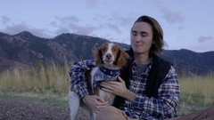 Portrait Of Young Man, Pets His Dog, Holds Her Close And Her Kisses Head, Smiles Stock Footage