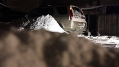 Car stuck in the snow. Paralyzed the movement of vehicles. Driver cleans the Stock Footage