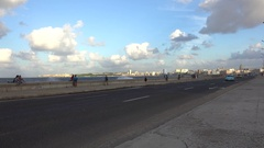 Road traffic with old American cars at the Havana Malecon. Cuba Stock Footage