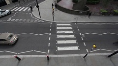 Pedestrian crossing with traffic and commuters Barbican London UK Stock Footage