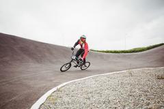 Cyclist riding BMX bike Kuvituskuvat