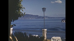 Vintage 16mm film, 1953 Italy, Lake Garda water skier with motorboat Stock Footage