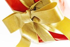 Gift red box with gold ribbon and bow isolated Stock Photos