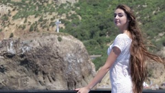 Sensual brunette with long hair in a light short white dress on a boat on a Stock Footage