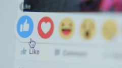 Touching to the icon (Like) in Facebook - close up, side Stock Footage