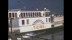 Vintage 16mm film, 1953 Switzerland, lake, side paddle ferry boat and hotel Stock Footage