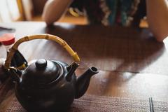 Close-up of teapot on dining table Stock Photos