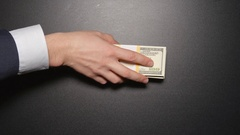 Corruption - Businessman give a money on a table (top view) Stock Footage