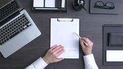 Businessman reading a contract Stock Footage