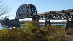 Clark Memorial Bridge Train Crossing the Ohio River Stock Footage