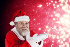 Composite image of santa claus with hands cupped Stock Photos