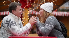 Romantic Couple Smiling on the Christmas Fair, Young Laughing Family Spends Time Stock Footage