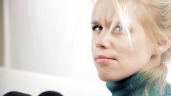 Beautiful blond woman blowing from face long blond hair smiling Stock Footage