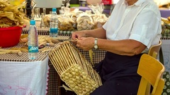 Old lady is weaving a basket Stock Footage