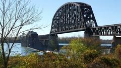 Clark Memorial Bridge Train Crossing the Ohio River Jefferson Indiana Stock Footage
