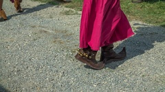 Marching with funny shoes and a red dress Stock Footage